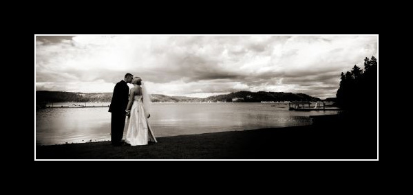 Bride and Groom Kiss the Sky
